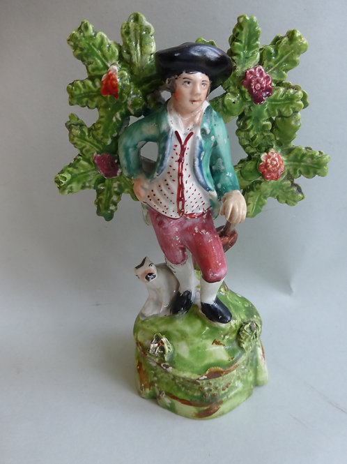 19THC STAFFORDSHIRE PEARLWARE OF MAN AND A DOG