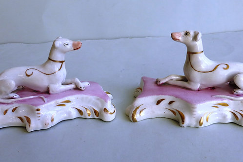 PAIR 19THC STAFFORDSHIRE PORCELLANOUS HOUNDS ON PINK BASES