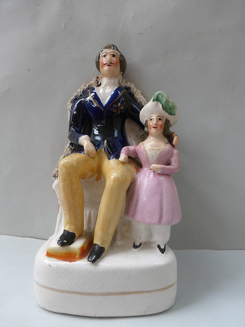 19thc staffordshire figure of Prince Albert with Princess Royal
