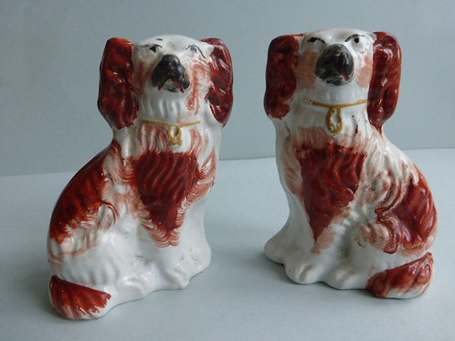 PAIR OF MINIATURE 19TH CENTURY STAFFORDSHIRE SPANIELS