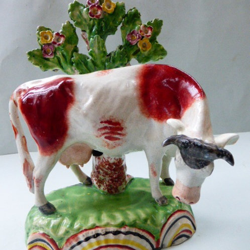 SUPERB 19THC STAFFORDSHIRE BY OBIDIAH SHERRATT OF COW ON RAINBOW BASE