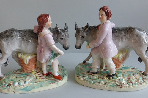 PAIR 19THC STAFFORDSHIRE GIRL AND BOY STANDING BESIDE DONKEYS