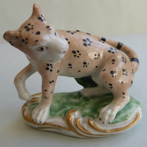 19THC STAFFORDSHIRE DERBY GROUP OF A LEOPARD