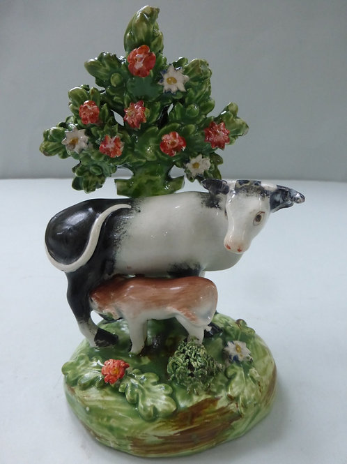 EARLY 19THC.STAFFORDSHIRE PEARLWARE COW AND CALF