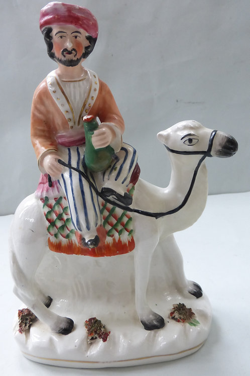 RARE 19THC STAFFORDSHIRE FIGURE OF AN ARAB RIDING ON A CAMEL