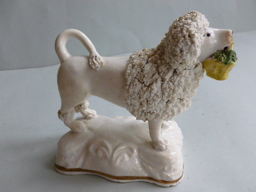 19TH CENTURY STAFFORDSHIRE POODLE HOLDING BASKET OF FLOWERS