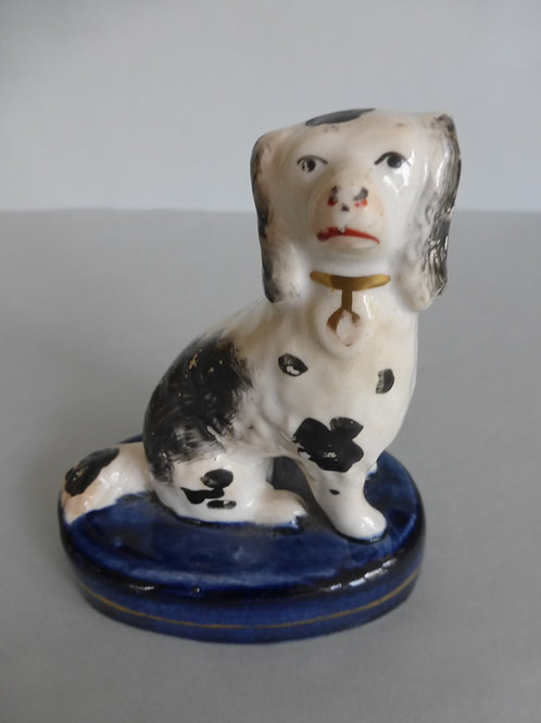 Late 19th century Staffordshire small dog on blue base