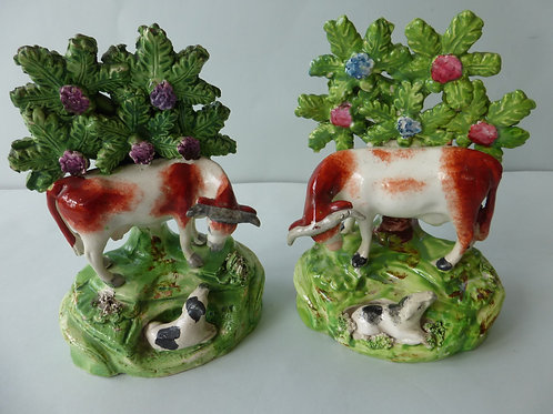 PAIR EARLY 19THC. STAFFORDSHIRE COW AND CALF GROUPS
