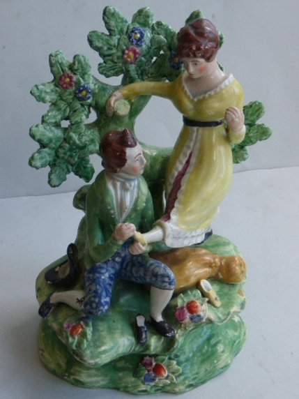 EARLY 19THC STAFFORDSHIRE PEARLWARE OF SHOEMAKER