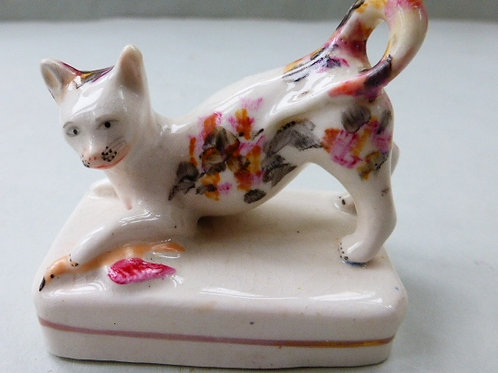 19THC STAFFORDSHIRE PORCELLANOUS FIGURE OF CAT