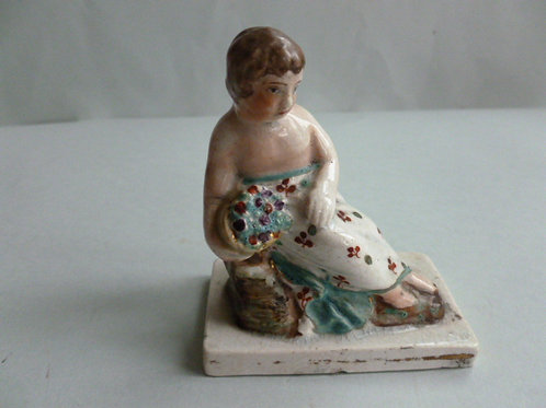19THC STAFFORDSHIRE PEARLWARE FIGURE OF GIRL