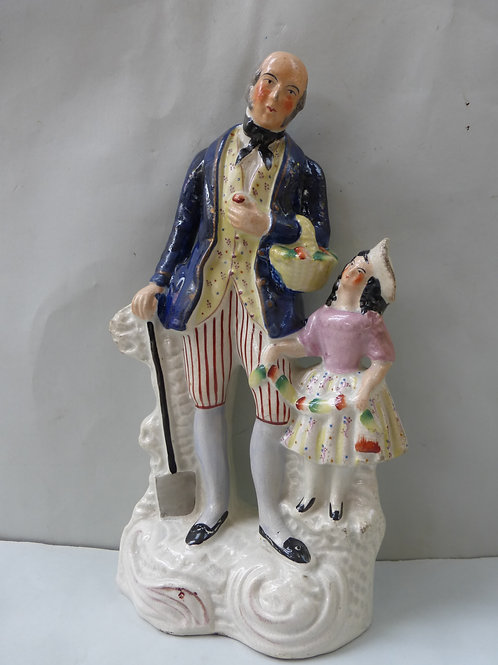 19THC STAFFORDSHIRE GROUP OF GARDNER WITH SMALL CHILD