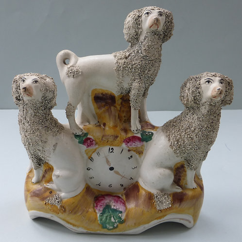 19THC. STAFFORDSHIRE POODLE CLOCK GROUP