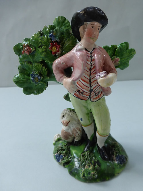 19THC. STAFFORDSHIRE PEARLWARE FIGURE WITH BOCAGE