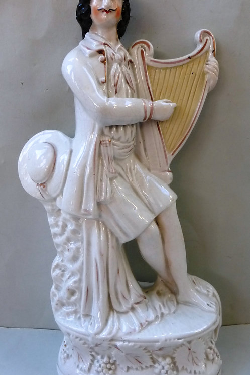 19TH CENTURY STAFFORDSHIRE OF MAN PLAYING A HARP