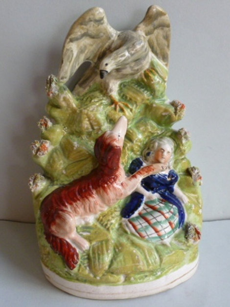 19THC STAFFORDSHIRE DOG PROTECTING GIRL FROM EAGLE