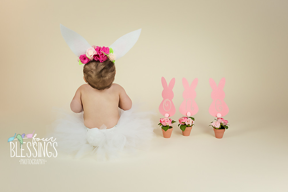Baby in a tutu and bunny ears