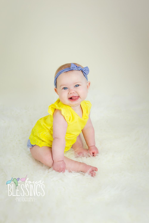 Baby girl sitting up