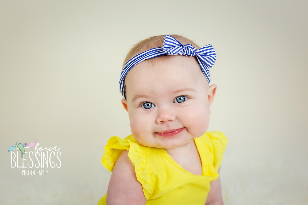 Baby girl with big blue eyes