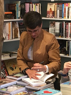Signing books at Womencrafts