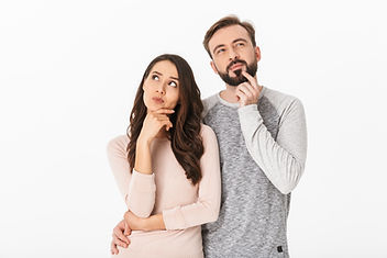 Image of serious thinking young loving couple isolated over white wall background looking