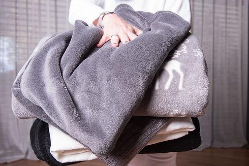 someone holing blankets.jpg
