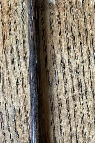 Palito de manicure com o bico de aço
