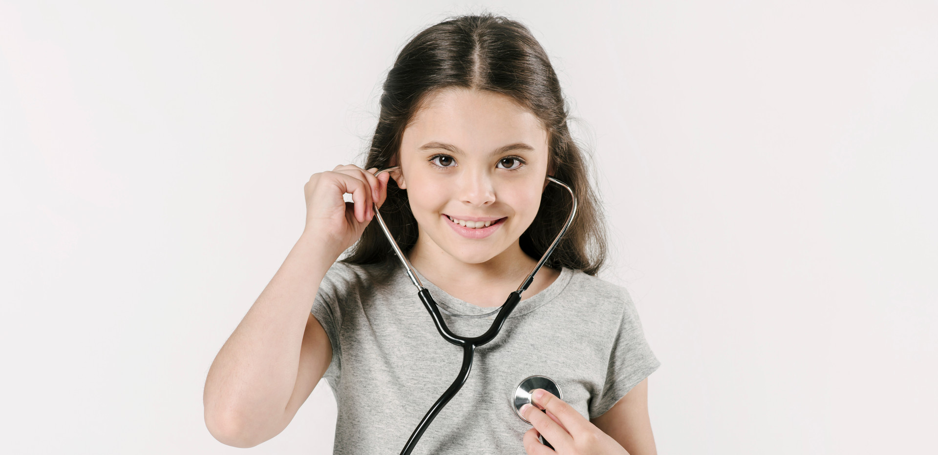 Little-girl-exploring-heartbeat-with-ste