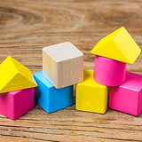 Building-blocks-on-wooden-background-Col