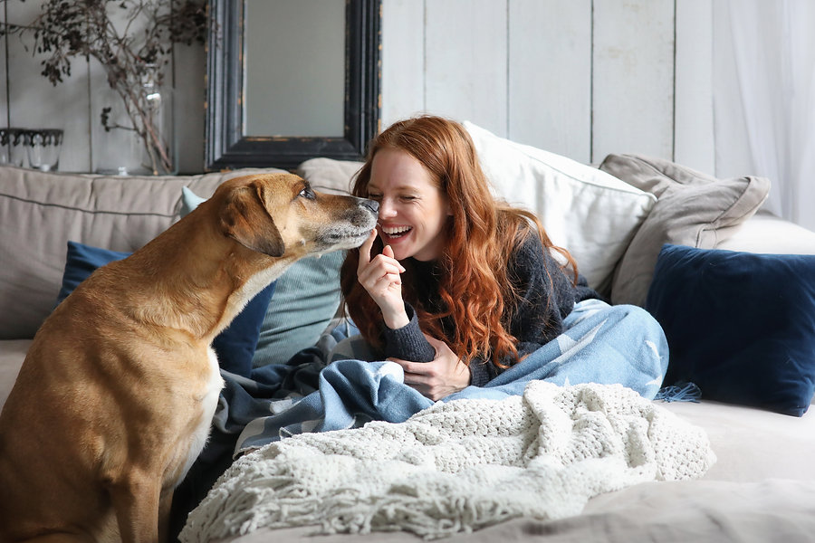 Red Head Woman on Couch with Dog.jpeg