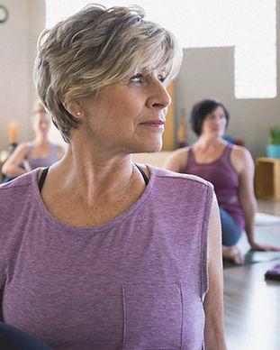 female_senior_doing_yoga_stretch-1296x72