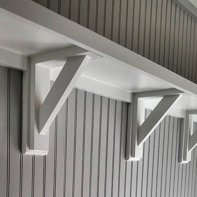 It's the small details that make the home.  Custom shelf brackets in our mudroom
