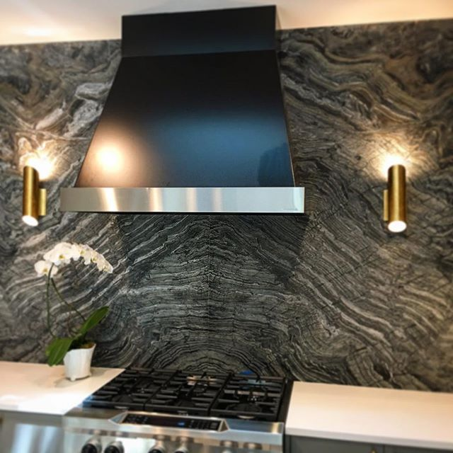 Results of coordination and diligence = awesome. Book matched wall slabs and inset sconces with 42_