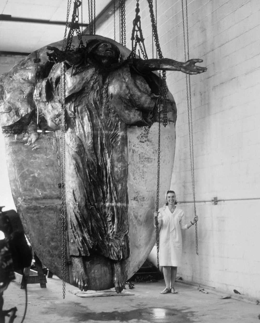 Luise Kaish next to sculpture Christ in Glory at Modern Art Foundry