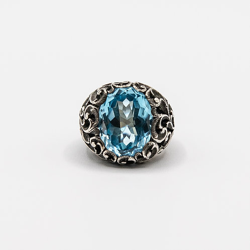 Silver Ring with Blue Topaz and Black Rhodium Plated Floral Motifs