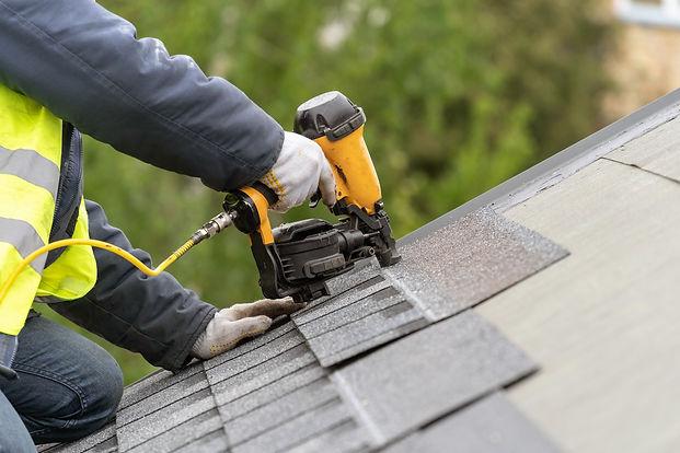 Unrecognizable roofer worker in uniform
