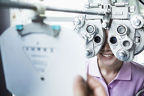 Patient eye exam behind phoropter