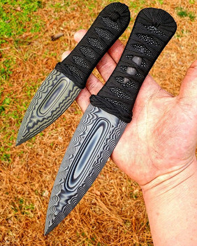 Large and small _Knapped Clovis_ dagger