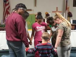 Youth Praying before Rehearsal