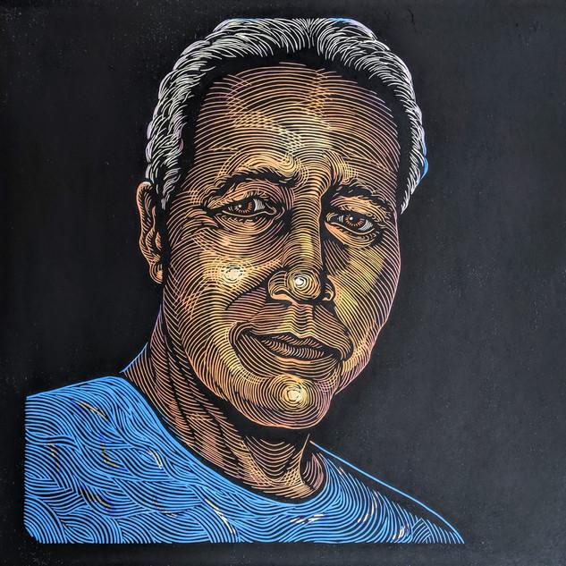 One World - Man in Blue Shirt.jpg