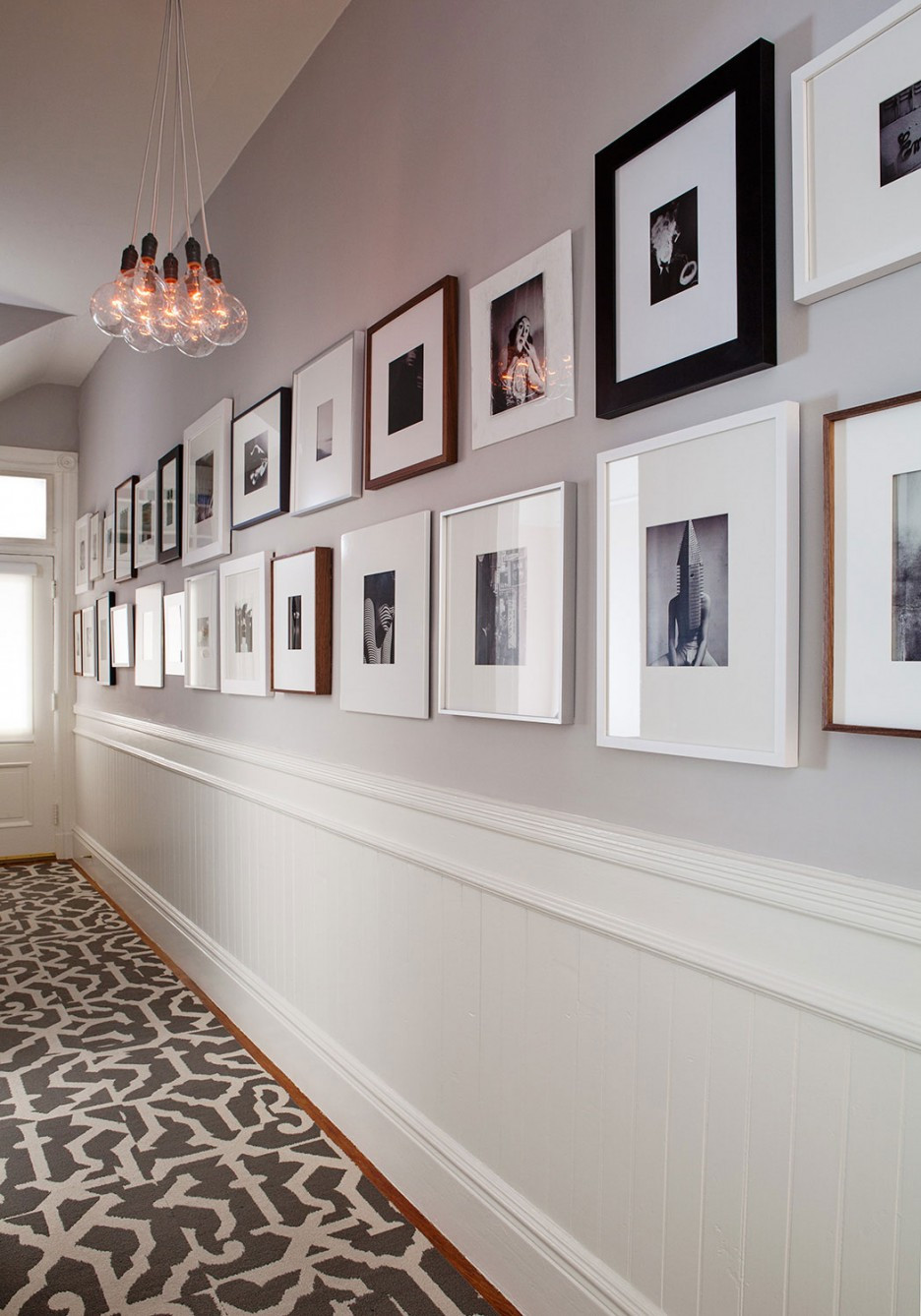 Adorable-Wall-Art-Studded-along-Capp-Street-Home-Hallway-Wall-Displaying-Framed-