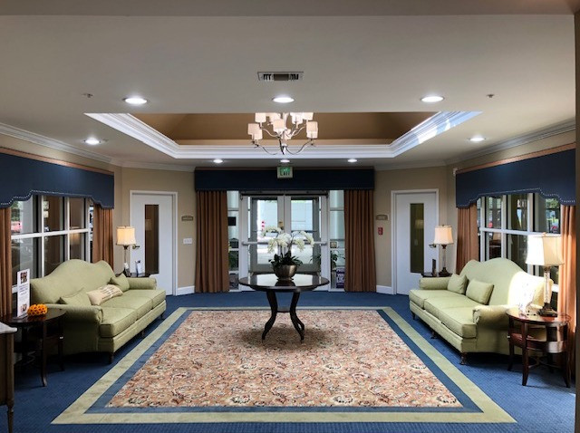 Assisted Living Lobby Shaped Cornices with decorative banding and nailhead trim over pinch pleat draperies
