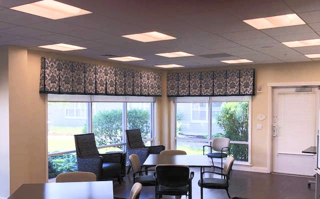Senior Living Atrium Box Pleat Valance over Roller Shades Notice the detail of the pattern matching
