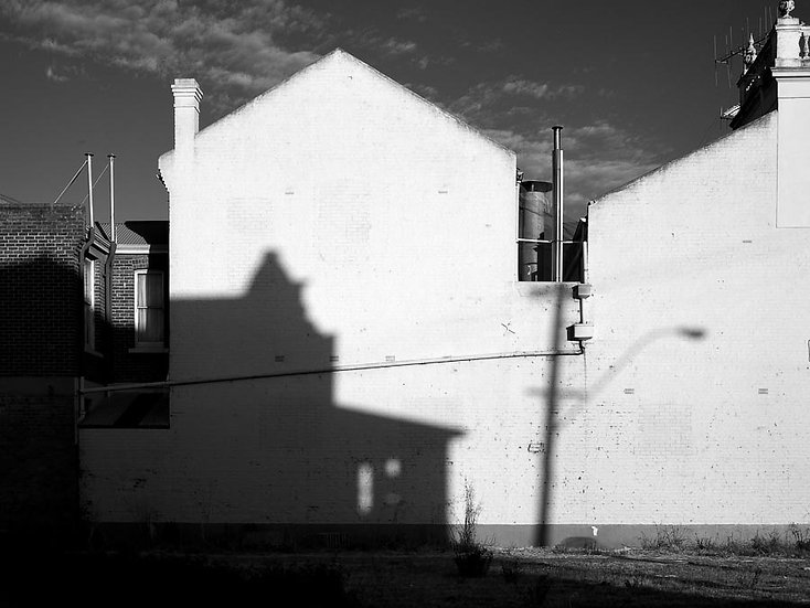 White wall, old building and shadows.