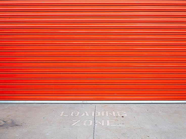 Loading zone and orange garage door
