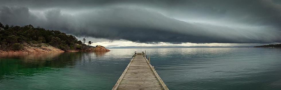 Timber jetty and storm clouds, Tasmania, Australia