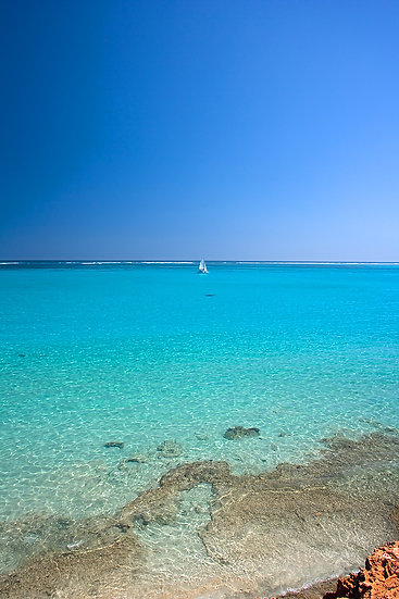 Reef, ocean and catamaran, Coral Bay, North Western Australia