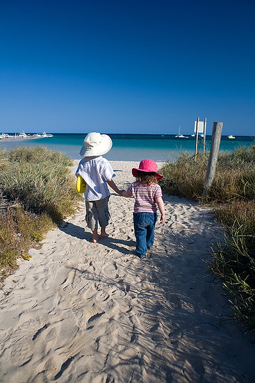 Children walking the the beach at Coral Bay, North Western Australia