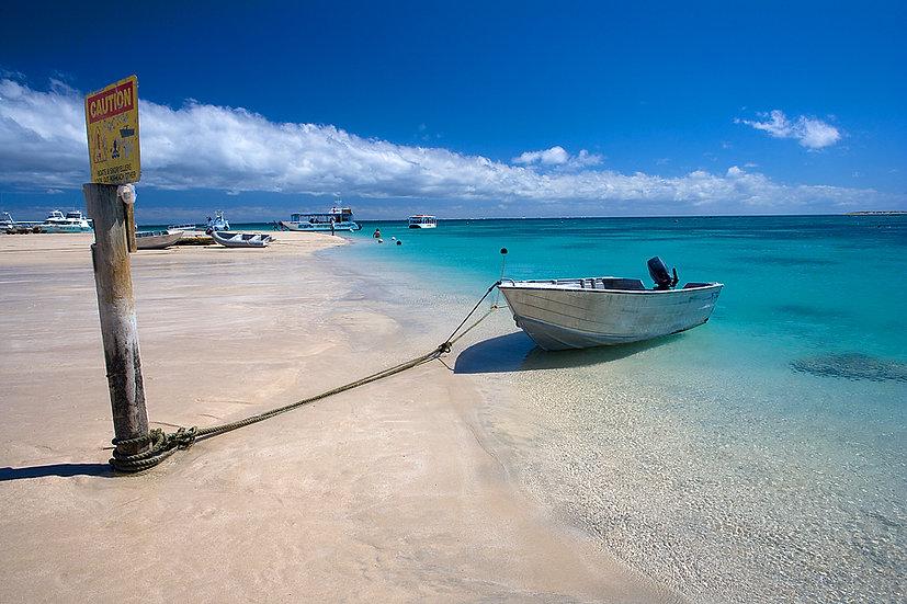 Boats, Coral Bay beach, North Western Australia