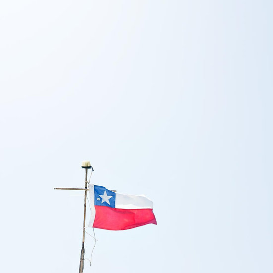 The Chile Flag Against A Blue Sky, South America